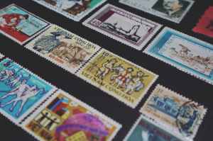 assorted colored vietnam postage stamps